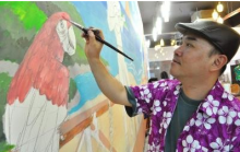 Lim Anuar working on the mural